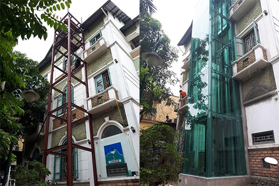 lắp thang máy bên ngoài nhà bằng khung thép và ốp kính